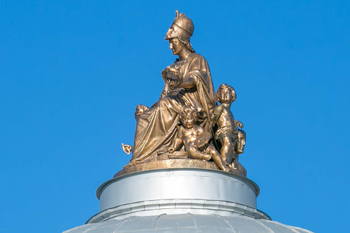 st-petersburg-ornamental-statue.jpg - An ornamental statue topping a cupola along the banks of the Neva River  in St. Petersburg, Russia.