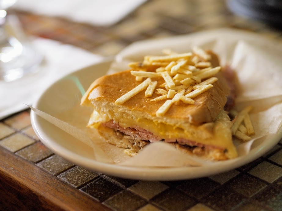 Cuban sandwich (or a Cubano) is made with ham, roasted pork, Swiss cheese, pickles, mustard, and sometimes salami on Cuban bread.