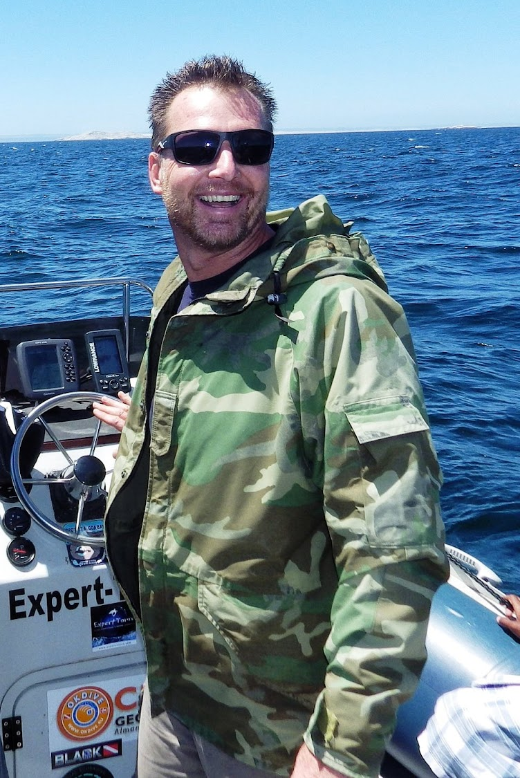 Rainer Schimpf at the wheel of his boat in Algoa Bay.