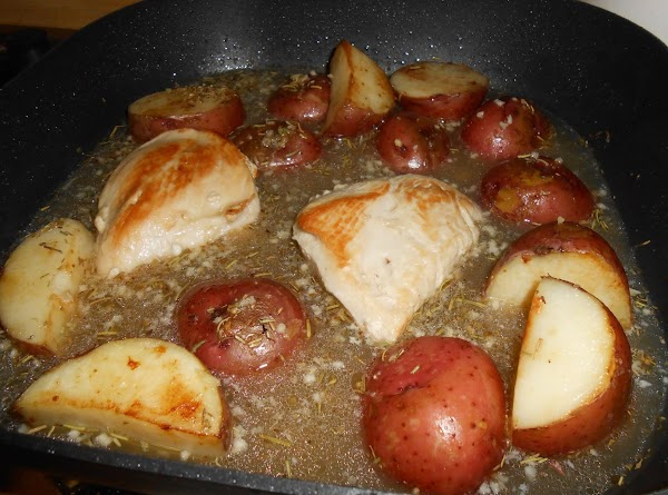 Add broth, wine and dressing; stir to scrape browned bits from bottom of skillet....