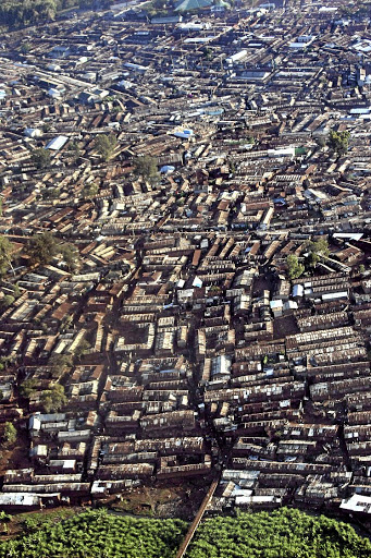 Urban sprawl: An aerial view of Africa's largest slum, Kibera, in Kenya. Experts at a conference in Uganda are considering ways to finance homes for low-income earners in Africa who don't have collateral. Picture: HALDEN KROG/THE TIMES