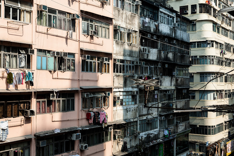 Photo: Laundry Day Everyday is laundry day in Hong Kong. You have to love the makeshift clothes lines people suspend from their apartments. This is a very common sight when you look up in Asia.  #hongkong #travel #asia #rooftopping #apartments #urbex, urbanexploration