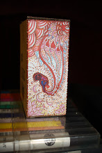 Photo: side paisley design with peppermint swirls, lotus blossoms, and hearts.