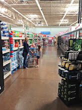 Photo: Since we needed water, we stopped by the water aisle first to compare the options. There were a lot of choices there.