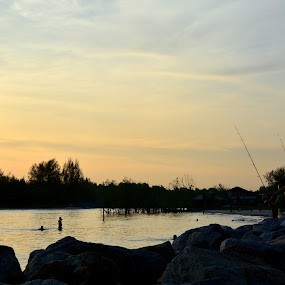 sunset and angler  by Zaidi Razak - Landscapes Sunsets & Sunrises