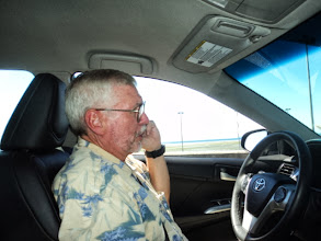 Photo: Dave letting his sister Lyn know that we were stuck at the border crossing. It took 45 minutes.