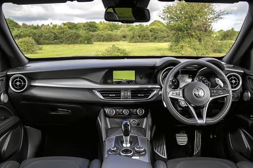 The dashboard and other aspects of the interior are basically the same as the Giulia sedan