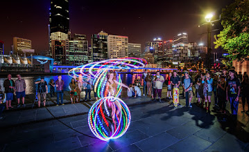 """Photo: The Light Dancer from the Melbourne PhotoWalk  After hour THREE of the mega-photowalk, we came across this gal. She said her name was """"Jane Fondle,"""" which I thought was kind of strange. And I thought it was even more strange when she gave me a brochure and it said that she does live performances in front of children so they stay in shape. Jane Fondle! hehe...  Anyway, this was a tough shot... as you can probably tell... getting HDR with movement is especially tricky -- and double-tricky when playing with light trails!  #MelbournePhotoWalk2013"""