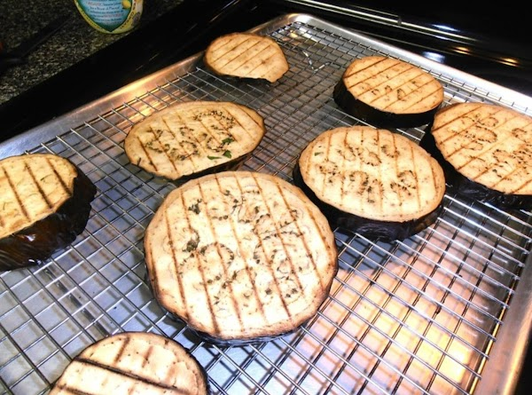 preheat oven to 425 degrees.  place  eggplant slices on a rack on...
