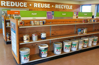 Photo: This room enphasizes Reuse. Paints and other materials that are still usuable are made available to the public for free. Each 5 gallon bucket contains a paint mixture, a dot of which is on the cover so a consumer knows what color he/she is getting.