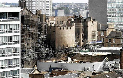 The last blaze at the Mackintosh building at the Glasgow School of Art was on June 17. Now plans have been approved to restore it again. Picture: REUTERS