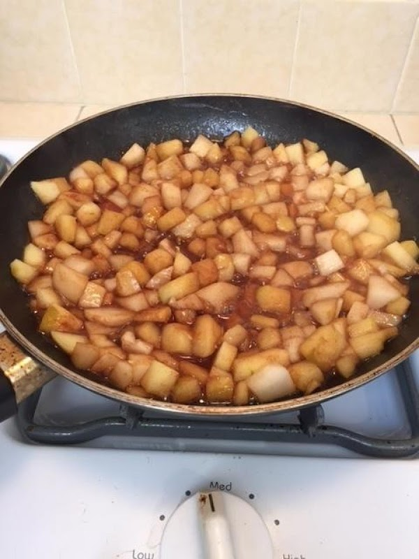 Add the pears and the remaining ingredients, except for the lemon zest, and cook...