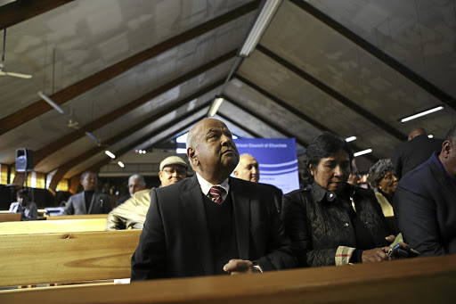 Call for prayers: Former finance minister Pravin Gordhan listens as South African Council of Churches general secretary Bishop Malusi Mpumlwana speaks at the Regina Mundi Church in Soweto, Johannesburg, on Thursday. Picture: THE TIMES