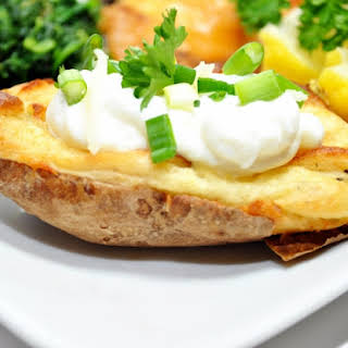 Twice Baked Potatoes With Bacon Sour Cream and Cheddar Cheese.