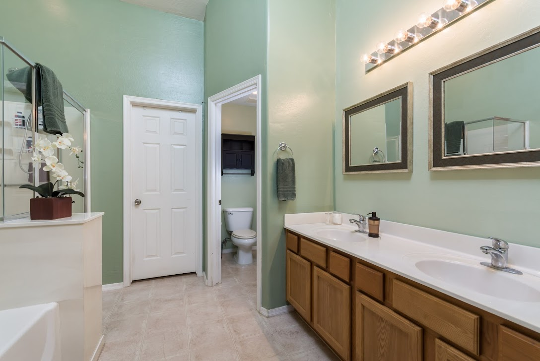 picture of master bathroom garden tub, walk-in shower, and double sinks