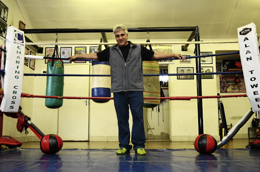 Alan Toweel in his garage, which he has turned into a gym to develop young talent.