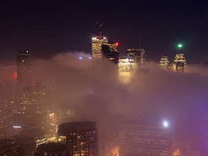 Photo: Fogtopping When low lying fog rolls into the city, I come out of retirement and sprint for the rooftops. Here's a shot testing out long exposures with the Olympus OM-D.  ISO: 200 Shutter: 8 seconds Aperture: F/8 Camera: Olympus OM-D E-M5 Lens: Panasonic Lumix 25mm F/1.4  #toronto  #rooftopping  #fog #skyline #urbex #urbanexploration