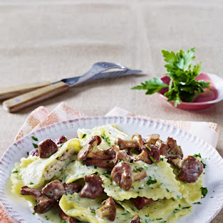 Ravioli in a Light Herb Cream with Chanterelle Mushrooms.