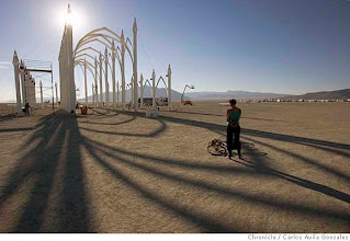 Photo: BURNINGMAN_018_CAG.JPGTanya Chapple of Berkley, Ca., watches the sun rise through the Cathedral art installation on Wednesday, August 29, 2006. Daily coverage of the Burning Man festival in the Nevada desert. Photo by Carlos Avila Gonzalez/The San Francisco ChroniclePhoto taken on 8/30/06, in Black Rock City, Nv, USA**All names cq (source)