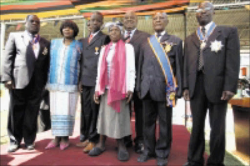 TOP HONOURS: Award recipients at the Zambian investiture ceremony at the country's 45th year of independence celebrations. In front is Getrude Nuthu Tambo (the late OR Tambo's younger sister). Pic. GARY VAN WYK.  28/ 10/2009. © Unknown.