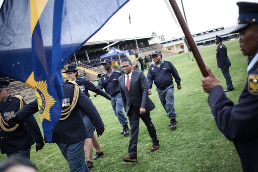 Police Minister Fikile Mbalula inspects a police guard during the launch of the newly trained Tactical Response Team at the police training ground in Pretoria. The TRT team underwent a new rigorous training programme aimed at improving reaction time and apprehension of perpetrators in medium to high risk incidents of crime. / Alaister Russell