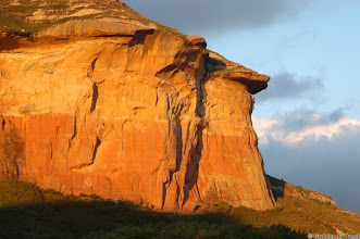 Photo: Mushroom Rock, a sandstone cliff in the the last rays of the setting sun. Golden Gate Highlands National Park (South Africa).