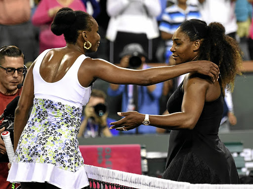 Sister act: Venus Williams, left, and sister Serena after their third-round match at Indian Wells, which Venus won to progress to the last 16. USA TODAY Sports