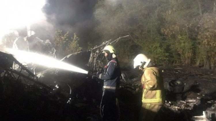 Fire at the crash site was extinguished late on Friday./REUTERS