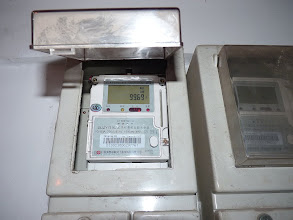 Photo: Beijing - electricity meter after I came home monday evening since electricity stopped working on Sunday lunch and I've got electricity prepaid card and slept one night in company, on right side slot for inserting electricity card to transfer data from charged card with money/kWh after what should be electricity start working, but when I got to home someone already charged electricity so I didn't have opportunity to try it and have to wait for next time, this is fresh counter I guess with charged amount of yuans at last charging, 100Y?, photo taken 111128