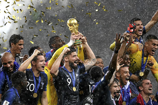 France captain Hugo Lloris lifts the World Cup trophy to celebrate with his teammates following their win over Croatia in yesterday's final at Luzhniki Stadium in Moscow.