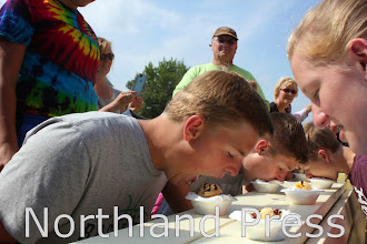 Photo: Michael Voss, of St. Michael, dives into his ice cream at the Lake Country Crafts and Cones Ice Cream Eating Contest. He took second in his division, ages 13-16. - photo by Kate Perkins