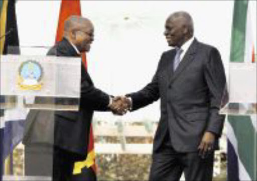 President Jacob Zuma' s first State visit in Angola. President Jacob Zuma  shake hands with the President of the Repubilck of Angola Jose Edwardo Dosantos after the press conferece.  PIC: SIMPHIWE NKWALI. 20/08/2009. © SUNDAY TIMES