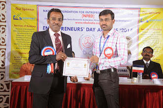 Photo: Prof. Dr. R. Ganesan, Chairman, NFED Issuing Certificate of Appreciation To Mr. Arun Duraisamy, Senior Editorial Assistant, Bonfring, Coimbatore