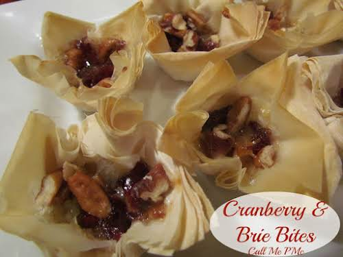 """Cranberry Brie Bites""""These Cranberry Brie Bites are simple to put together. With..."""