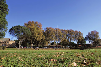 Photo: AH Smith Oval during winter season. From left to right the Administration Building, Kit and Clothing Shop and Memorial Cricket Pavilion can be seen.