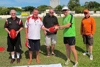 Photo: Ron Vernon presents the match ball to Adam McDonald. Photo, Dani Moger.