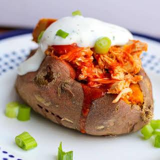 Buffalo Chicken Stuffed Sweet Potato with Greek Yogurt Ranch Dressing.