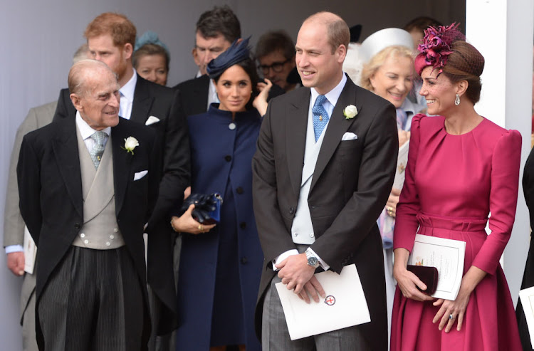 Prince Philip, Duke of Edinburgh, Meghan, Duchess of Sussex, Prince William, Duke of Cambridge and Catherine, Duchess of Cambridge attend the wedding of Princess Eugenie of York and Jack Brooksbank at St George's Chapel in Windsor Castle on October 12 2018 in Windsor, England.