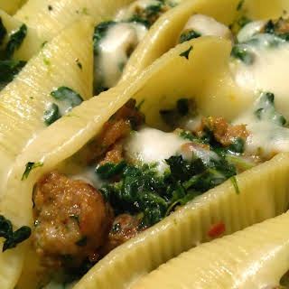 Sausage and Spinach Stuffed Shells with Garlic Cream Sauce.