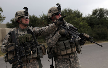Photo: U.S. Army Soldiers of 1st Squadron, 61 Cavalry Regiment, Charlie Troop, Second Platoon, observe movement during a patrol in the village of Akeemabad, Afghanistan, Sept. 16, 2010.   (US Army Photo by Spc. David A. Jackson/Released)