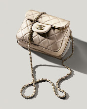 """Photo: CHANEL """"Timeless Classic"""" pale gold metallic lambskin cross-body mini flap bag with wallet. $1,800. Also available in red caviar leather, black caviar leather or yellow lambskin. Italy. Main Floor. 212 872 2858"""