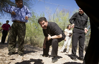 Photo: Bishop Oscar Cantu of Las Cruces, N.M., ducks under a barbed wire fence as a group of U.S. bishops tours an area of the Arizona desert north of Nogales March 31. The bishops participated in a two-day tour focused on U.S.-Mexico border issues and used the opportunity to again appeal for change sin the U.S. immigration system. (CNS photo/Nancy Wiechec) (April 1, 2014)