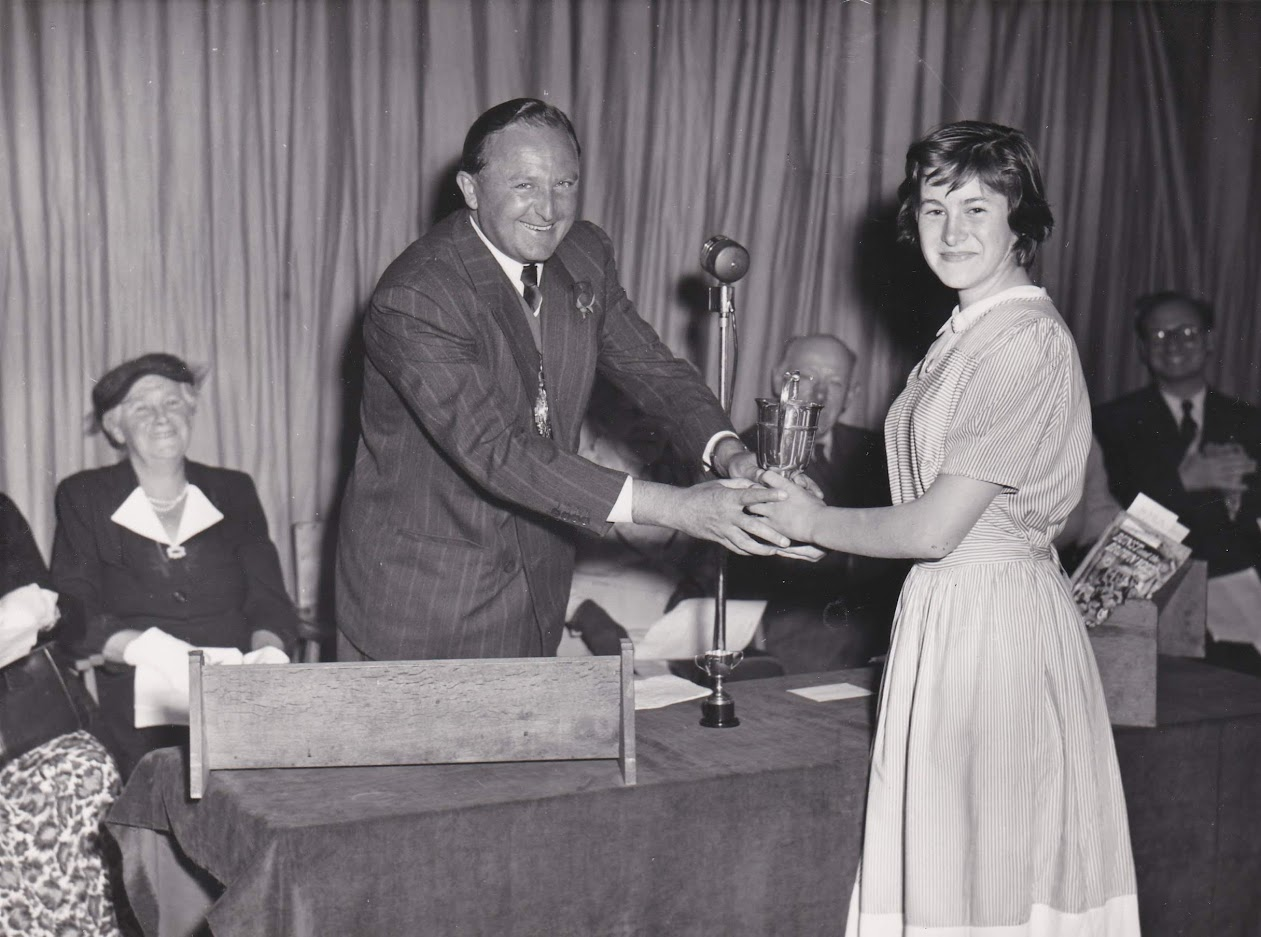 Sheila Tierney receiving the Day Cup from Councillor S J Day Mayor of Tenterden at the 1953 Homewood School Prize Day
