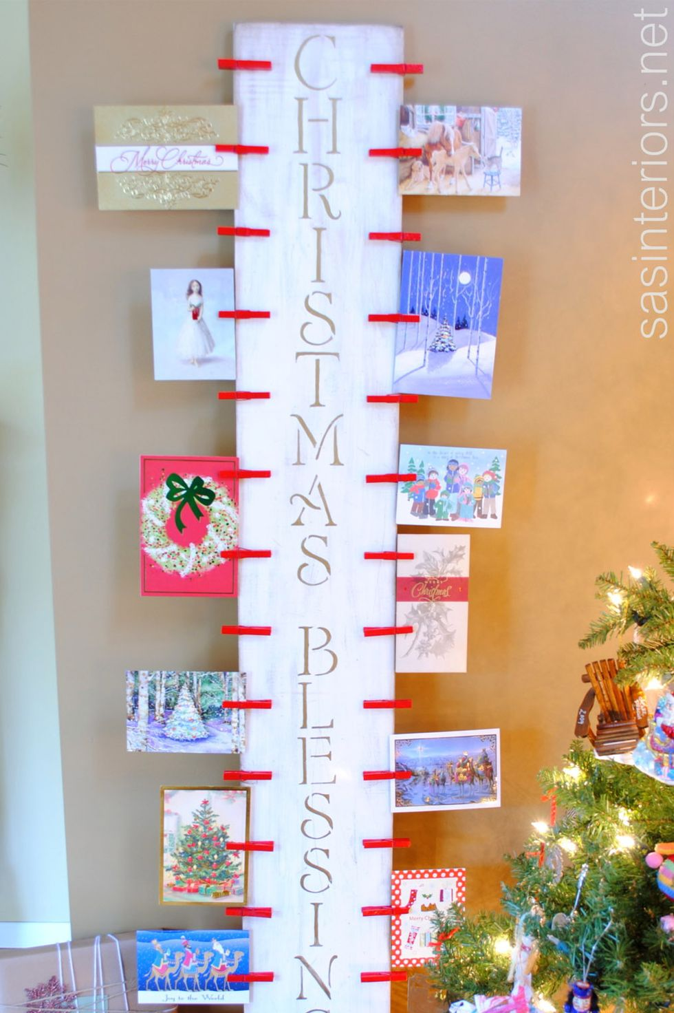 Wooden Christmas Card Display: These 25 DIY Christmas Card Holders - That Double As Festive Decor will allow you to beautifuly display your cards and will also give you some great decor.