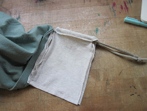 Photo: Here's the drawstring bag (inside out), sewn to the inside of the grocery bag (also inside out).