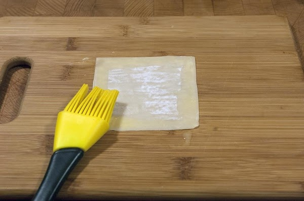 Brush some egg wash on the edges of a wonton wrapper.