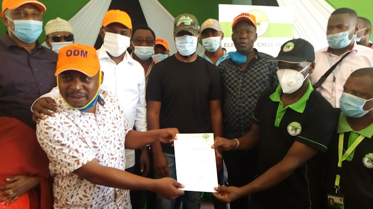 ODM candidate Omar Boga receives his clearance certificate for the Msambweni by-election from the IEBC in Kwale on Friday, October 16, 2020.