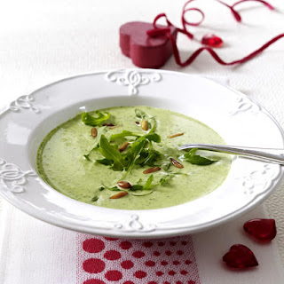Cream of Arugula Soup with Toasted Pine Nuts.