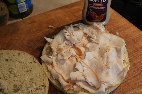 Layer sliced chicken breast over mayonnaise.