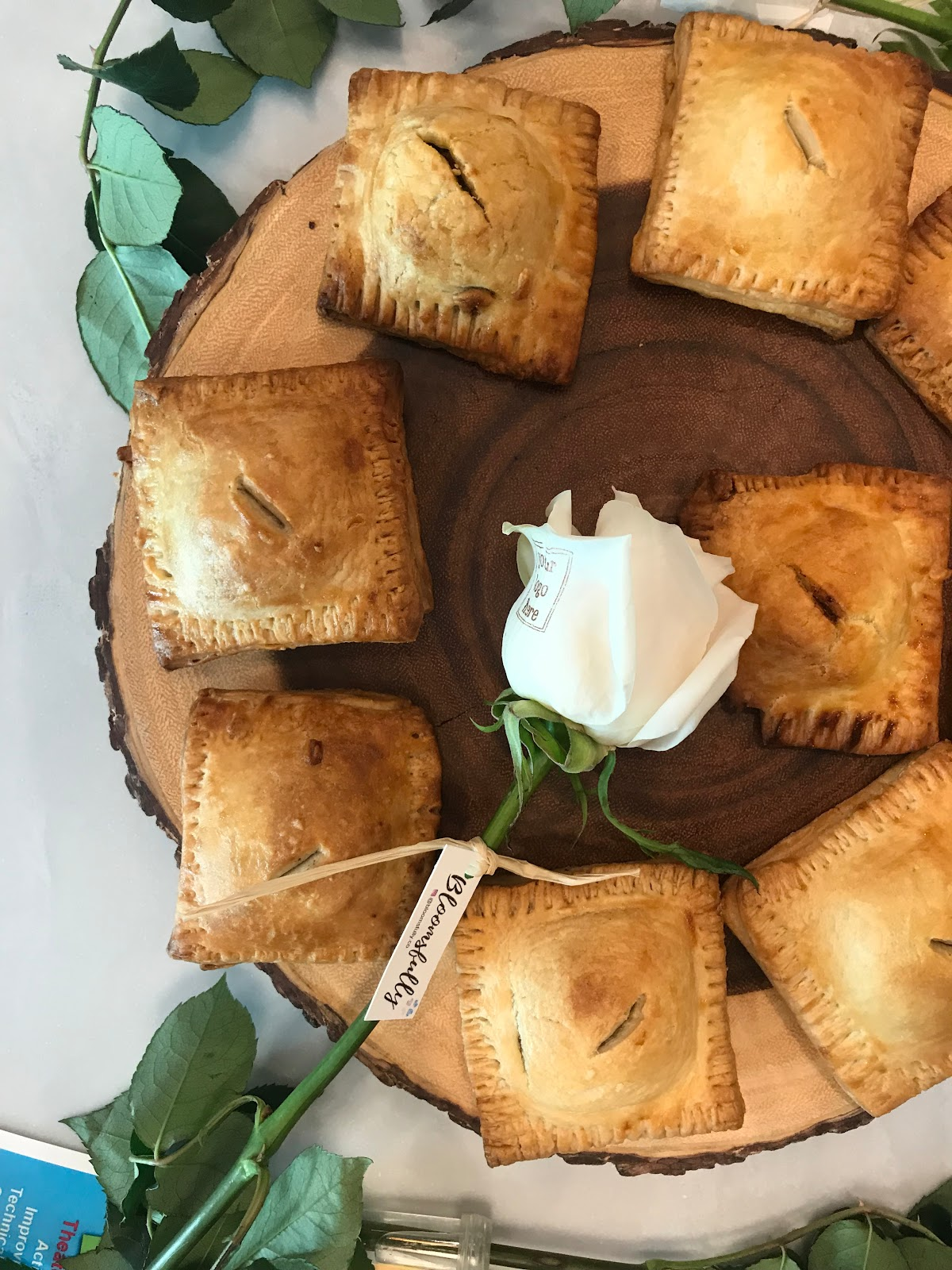 Our host, Nanndi's, handmade meat pies. And a customizable rose from our sponsor, Bloomsfully.